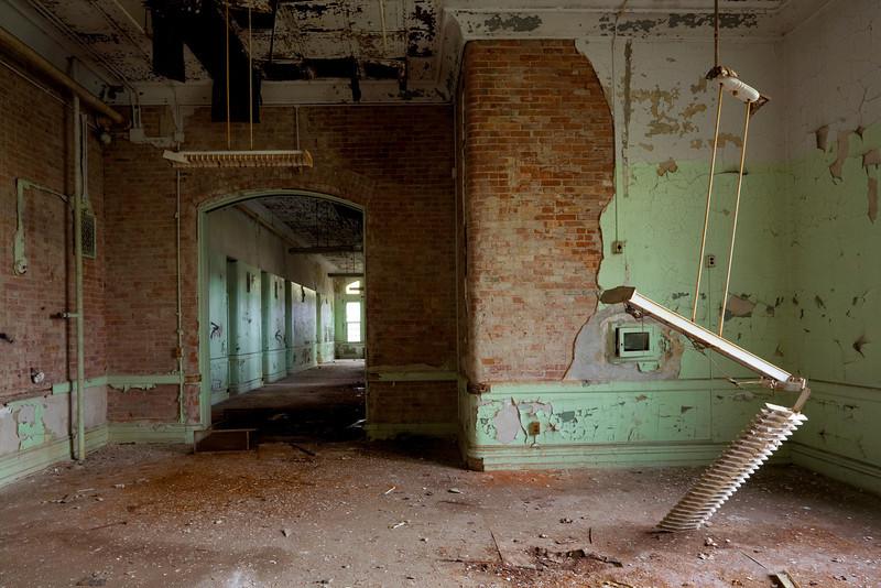 Fallen florescent light in dayroom of inner brick ward, Buffalo State Hospital.