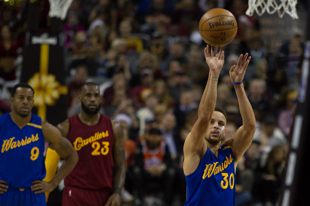 . Stephen Curry (30) of the Golden State Warriors shoots a foul shot during an NBA game at the Quicken Loans Arena on Chritmas day.  The Cavs defeated the Warriors 109-108.  Michael Johnson - The News Herald