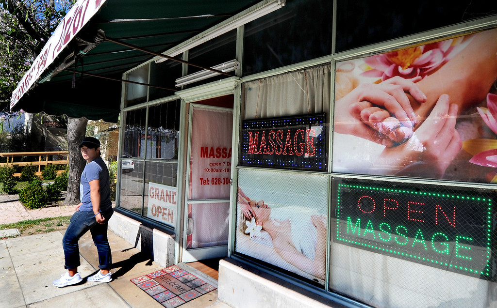 . A person leaving Lucky Energy Spa on North Hill Avenue in Pasadena. (Photo by Walt Mancini/Pasadena Star-News)