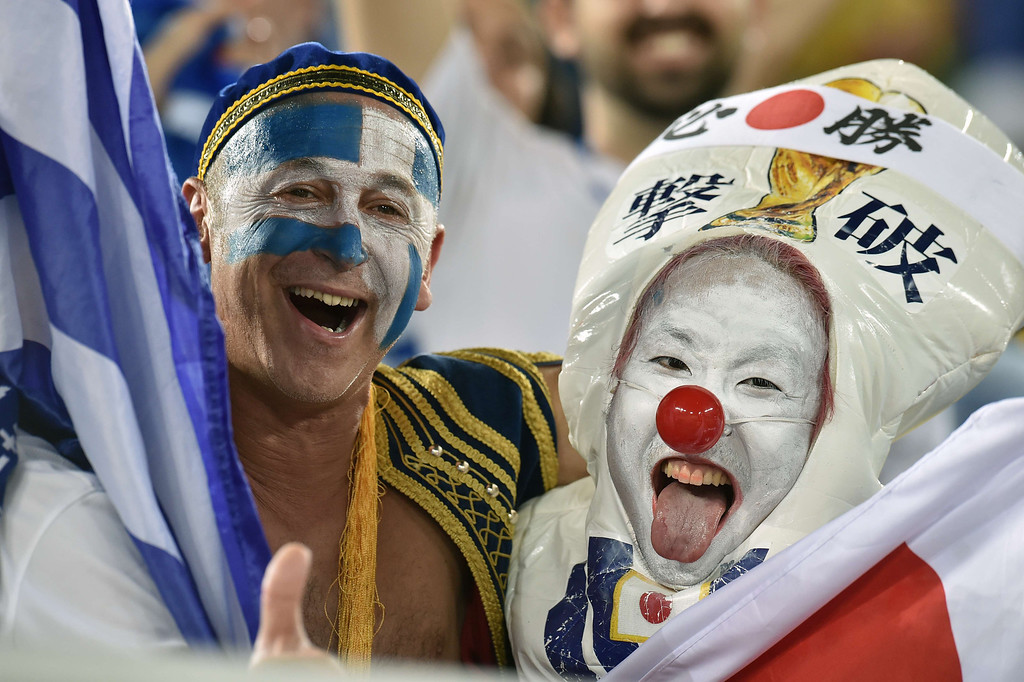 . Japan and Greece fans cheer before the start of a Group C match between Japan and Greece at the Dunas Arena in Natal during the 2014 FIFA World Cup on June 19, 2014.  ARIS MESSINIS/AFP/Getty Images