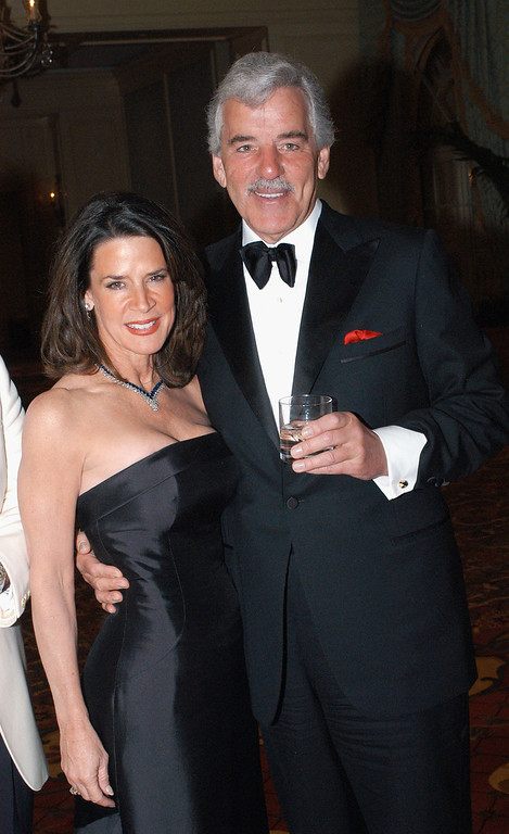 . U.S. Representative Katherine Harris (L) poses with actor Dennis Farina (R)  pose at the Ball Des Sports Gala Evening at the Festhalle on February 4, 2005 in Frankfurt, Germany. (Photo by Ralph Orlowski/Getty Images)