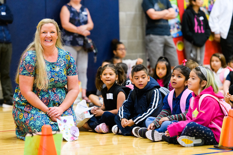 Kindergarten teacher Jessica Patterson sits with her new students during the daily affirmation in the gymnasium. Back to school day at Hallman Elementary School on Wednesday, September 4, 2019 in Salem, Ore.