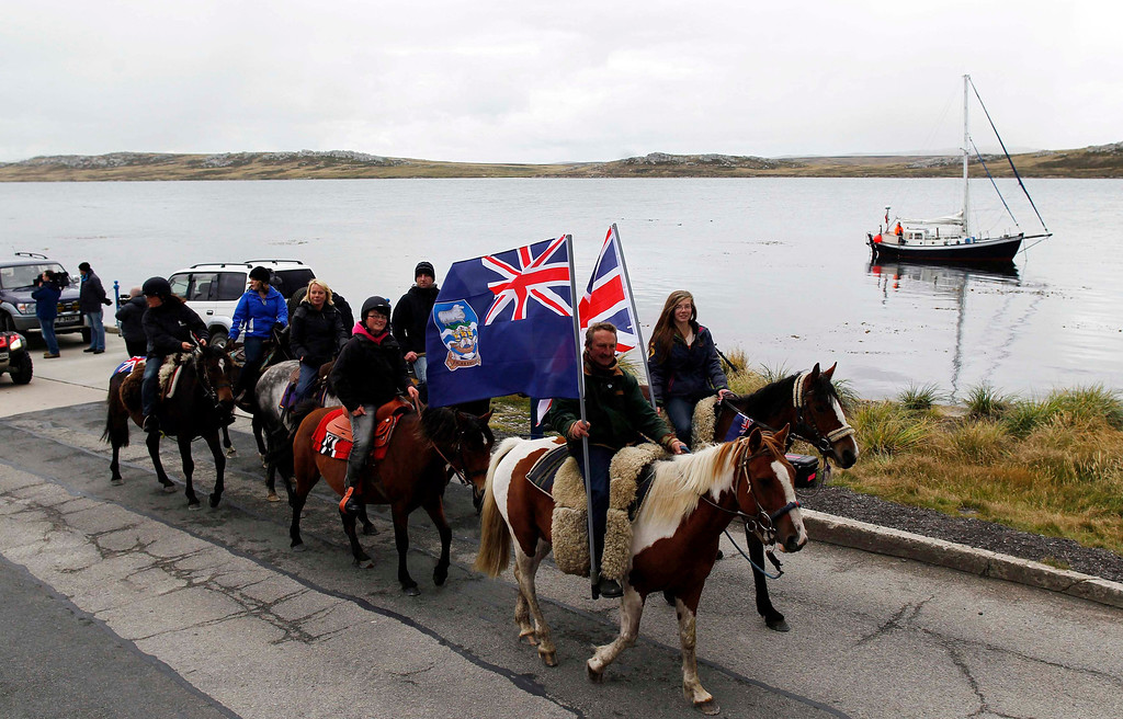 . Falkland islanders ride their horses during a parade in Stanley, March 10, 2013. Voters in the remote British-ruled Falkland Islands hold a referendum on their future today that seeks to challenge Argentina\'s increasingly vocal sovereignty claim. REUTERS/Marcos Brindicci