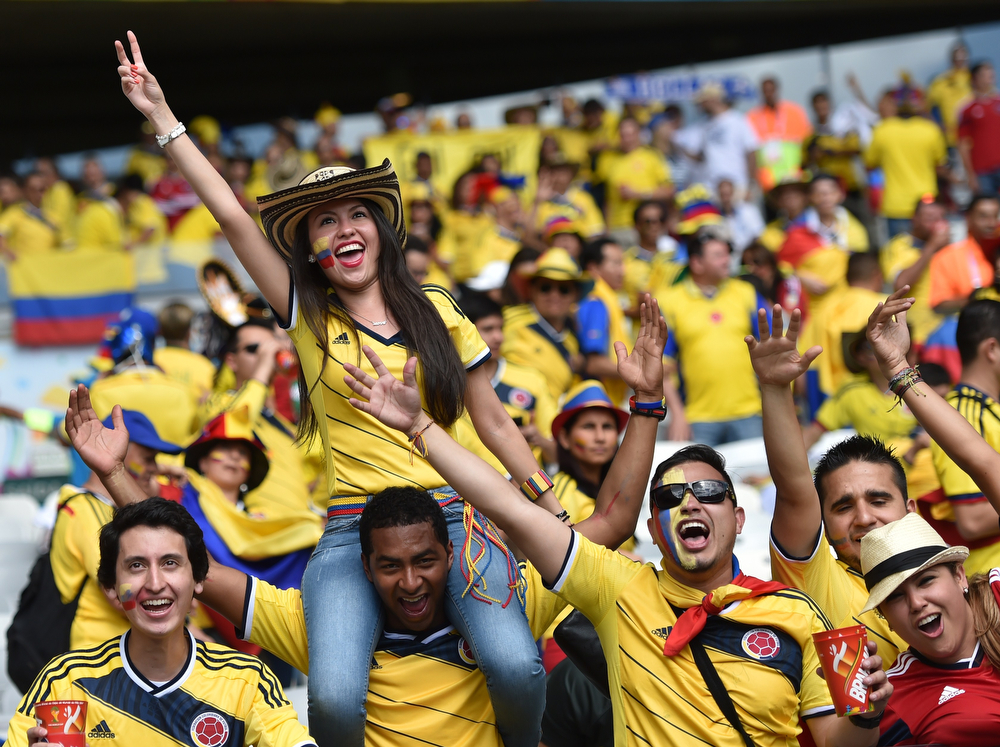 . Colombian supporters wait for the start of a Group C football match between Colombia and Greece at the Mineirao Arena in Belo Horizonte during the 2014 FIFA World Cup on June 14, 2014. (ARIS MESSINIS/AFP/Getty Images)