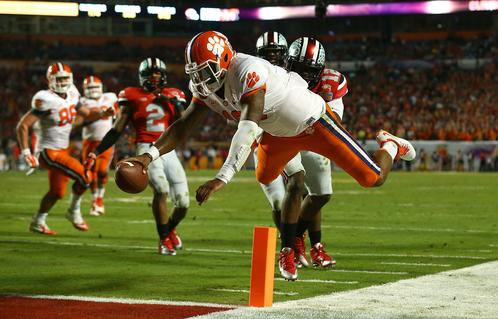. MIAMI GARDENS, FL - JANUARY 03: Tajh Boyd #10 of the Clemson Tigers dives for the endzone attempting to score a touchdown in the fourth quarter against the Ohio State Buckeyes during the Discover Orange Bowl at Sun Life Stadium on January 3, 2014 in Miami Gardens, Florida. Boyd stepped out of bounds on the play and was ruled down. (Photo by Streeter Lecka/Getty Images)