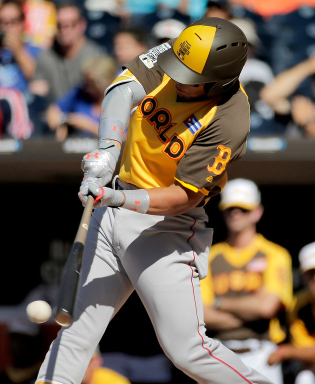 . World Team\'s Yoan Moncada, of the Boston Red Sox, hits against the U.S. Team during the first inning of the All-Star Futures baseball game, Sunday, July 10, 2016, in San Diego. (AP Photo/Matt York)