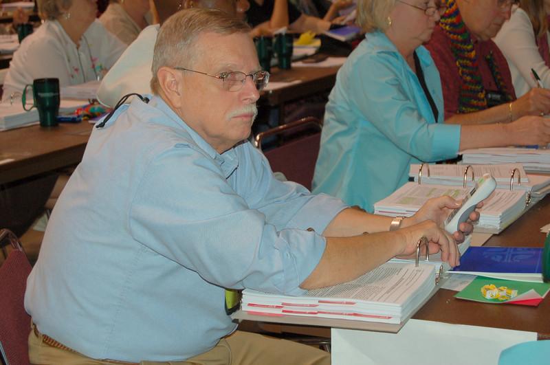 Voting member casts his vote.
