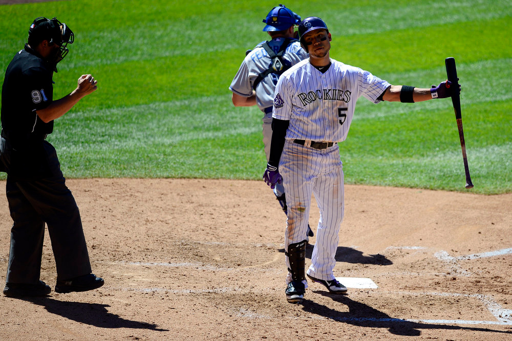 . Colorado Rockies left fielder Carlos Gonzalez (5) reacts to striking out with two runners on in the fourth during action in Denver. The Colorado Rockies hosted the Los Angeles Dodgers at Coors Field. (Photo by AAron Ontiveroz/The Denver Post)