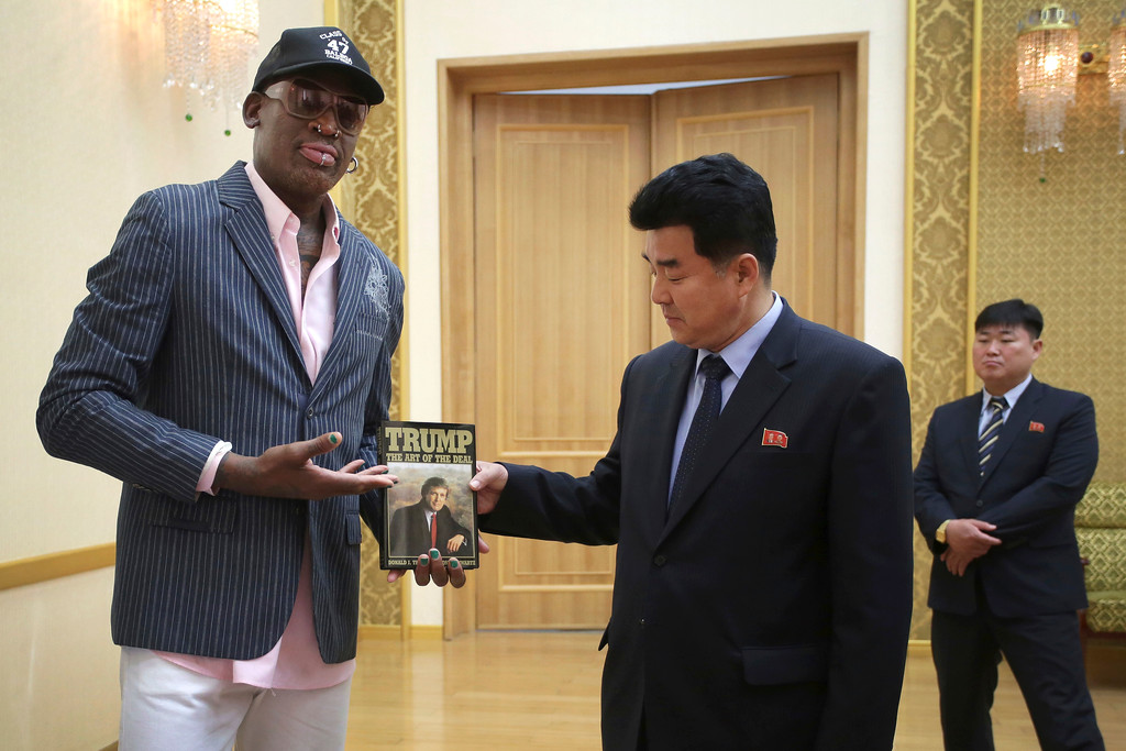 ". Former NBA basketball star Dennis Rodman presents a book titled ""Trump The Art of the Deal\"" to North Korea\'s Sports Minister Kim Il Guk Thursday, June 15, 2017, in Pyongyang, North Korea. (AP Photo/Kim Kwang Hyon)"