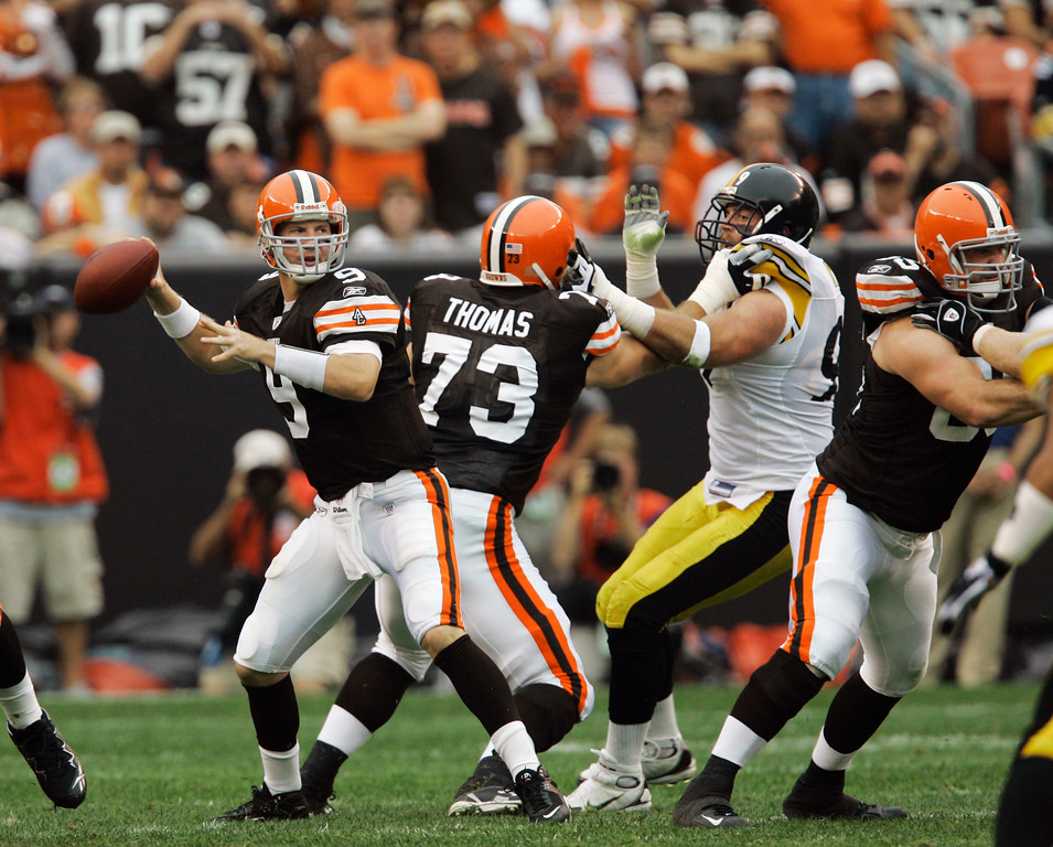. Cleveland Browns quarterback Charlie Frye (9) looks to pass as Browns tackle Joe Thomas (73) wards off Pittsburgh Steelers defensive end Brett Keisel in the first quarter of an NFL football game Sunday, Sept. 9, 2007, in Cleveland. (AP Photo/Tony Dejak)