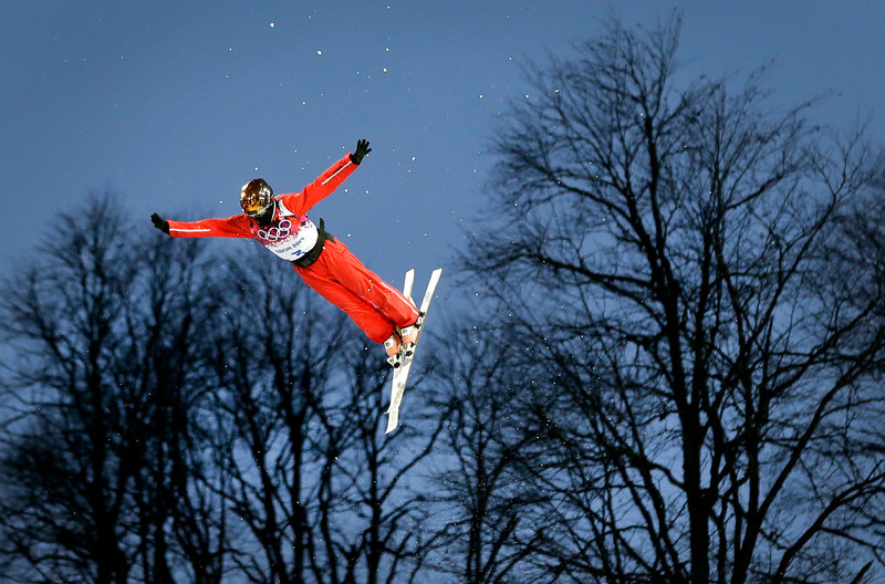 . China\'s Xu Mengtao jumps during a women\'s freestyle skiing aerials qualifying round at the Rosa Khutor Extreme Park, at the 2014 Winter Olympics, Friday, Feb. 14, 2014, in Krasnaya Polyana, Russia. (AP Photo/Patrick Semansky)