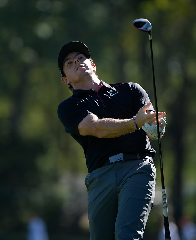 . CHERRY HILLS VILLAGE, CO. - SEPTEMBER 03:  Pro golfer, Rory McIIroy, tries to catch his club after he tossed it into the air on the 3rd tee box  during the FedExCup BMW Championship Pro-Am at the Cherry Hills Country Club Wednesday, September 03, 2014. His shot ended up in a clump a small trees. (Photo By Andy Cross / The Denver Post)