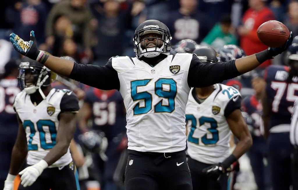 . JACKSONVILLE JAGUARS - Jacksonville Jaguars defensive end Ryan Davis (59) celebrates his interception against the Houston Texans during the fourth quarter of an NFL football game on Sunday, Nov. 24, 2013, in Houston. (AP Photo/David J. Phillip)