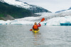 Young woman paddling in a kayak around Mendenhall Glacier in Mendenhall Lake
