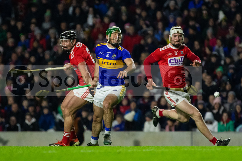 Tipperary's John O'Dwyer against Cork's Colm Spillane and Chris O'Leary