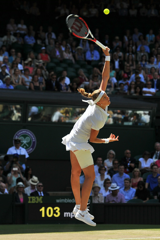. Czech Republic\'s Petra Kvitova serves to Czech Republic\'s Lucie Safarova during their women\'s singles semi-final match on day ten of the 2014 Wimbledon Championships at The All England Tennis Club in Wimbledon, southwest London, on July 3, 2014. Kvitova won 7-6, 7-1.  GLYN KIRK/AFP/Getty Images