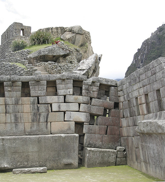 The only real area within Machu Picchu that shows signs of a deteriorating wall. The site has survived hundreds of years of weather and earthquakes. The reason this damage has occured is that without a roof, the rain has seeped into the ground under the wall, and the weight of the wall has caused the ground to sink.