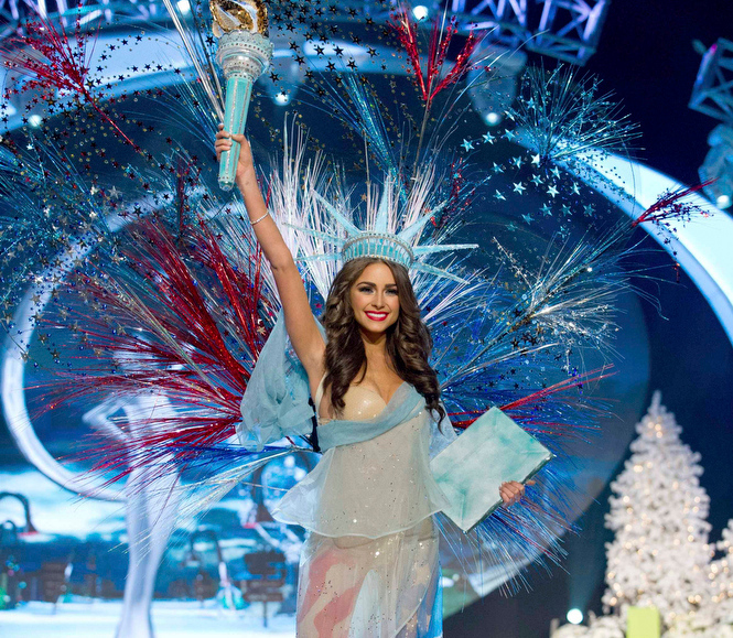 Description of . Miss USA Olivia Culpo performs onstage at the 2012 Miss Universe National Costume Show at PH Live in Las Vegas, Nevada December 14, 2012. The 89 Miss Universe Contestants will compete for the Diamond Nexus Crown on December 19, 2012. REUTERS/Darren Decker/Miss Universe Organization/Handout