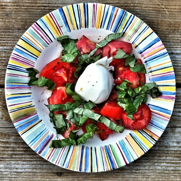 On the table tonite: colors of summer. #tomatoes #caprese #basil #buratta #food #foodie #jux