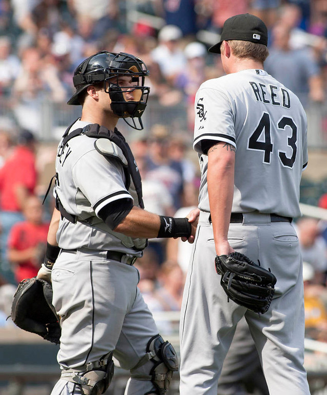 . Chicago White Sox relief pitcher Addison Reed is congratulated by teammate Josh Phegley after they defeated the Minnesota Twins 5-2.  (AP Photo/Paul Battaglia)