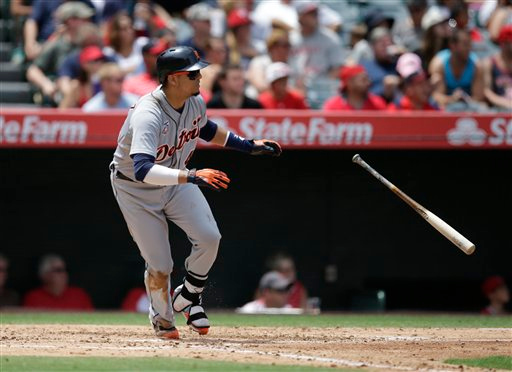 . Detroit Tigers\' Victor Martinez watches his line drive during the fourth inning of a baseball game against the Los Angeles Angels on Sunday, July 27, 2014, in Anaheim, Calif. (AP Photo/Jae C. Hong)