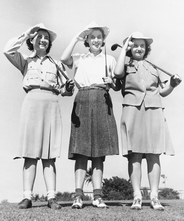. From left to right:  Louise Suggs of Lithia Springs, Ga.; Dorothy Kirby of Atlanta, Ga.; and Georgia Tainter of Fargo, N.D., give a salute at the annual Miami Biltmore Women\'s Championship, Jan. 24, 1942.  (AP Photo)