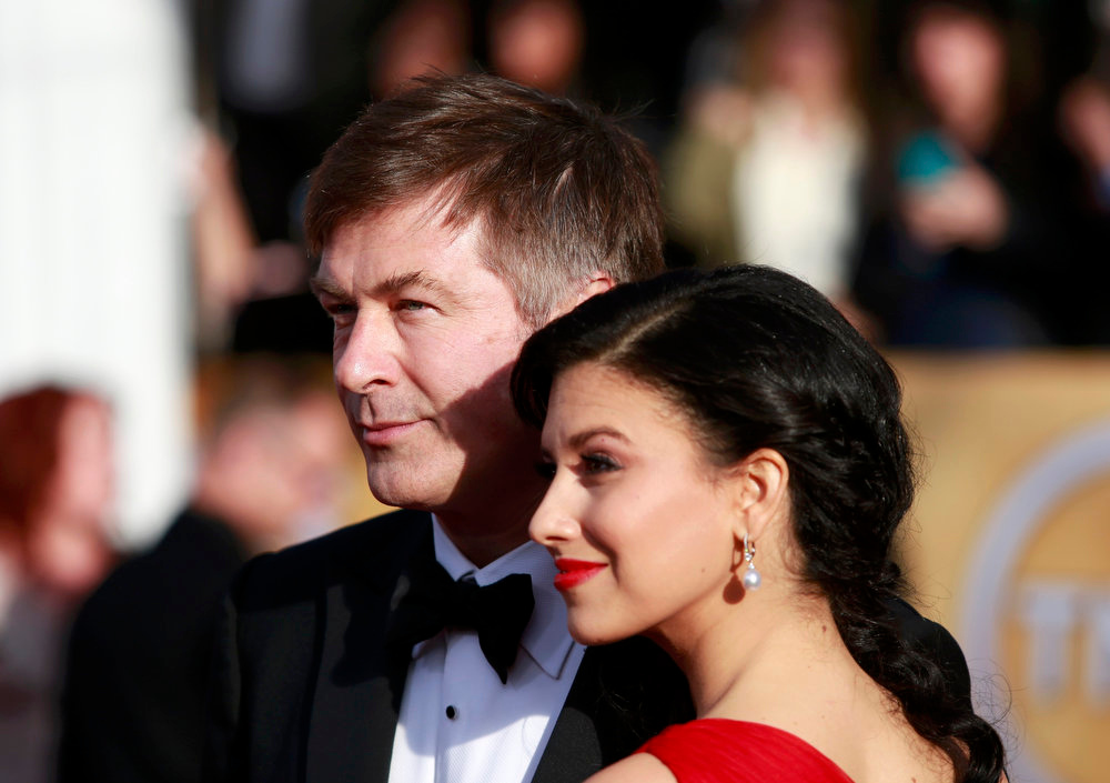 ". Actor Alec Baldwin, of the television comedy ""30 Rock\"" and his wife Hilaria Thomas arrive at the 19th annual Screen Actors Guild Awards in Los Angeles, California January 27, 2013.  REUTERS/Adrees Latif"