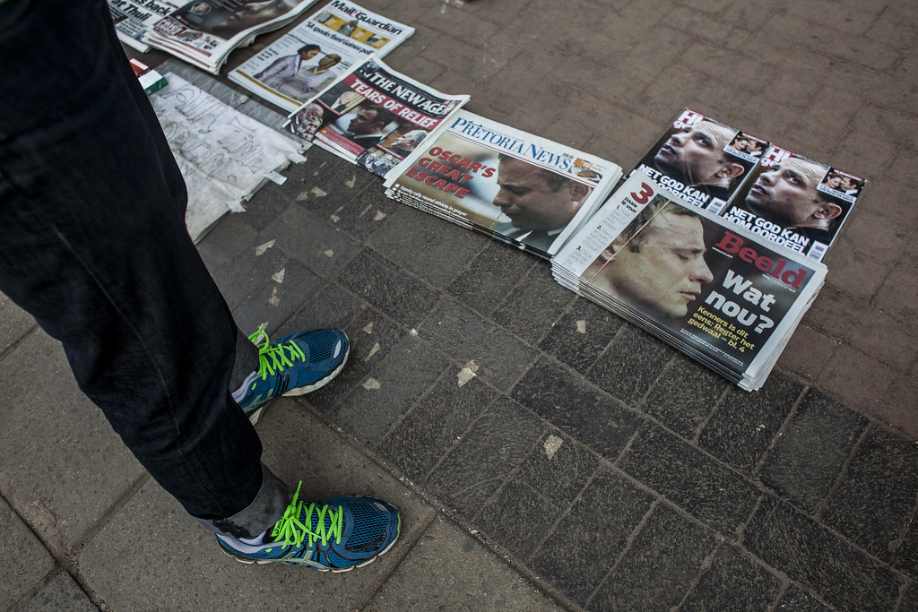 . A newspaper headlines Oscar Pistorius as he is given bail at North Gauteng High Court on September 12, 2014 in Pretoria, South Africa. South African Judge Thokosile Masipa ruled out murder charges yesterday, but convicted Oscar Pistorius in court today of culpable homicide, as the six month trial of the Olympic double-amputee sprinter comes to an end.  (Charlie Shoemaker/Getty Images)