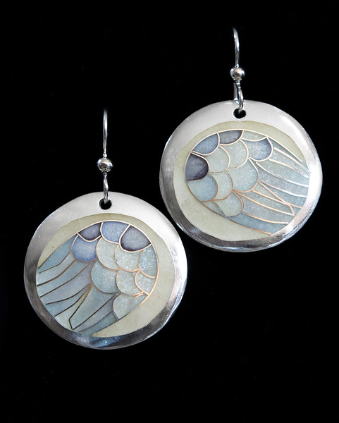Fine Silver Champlevé and Cloisonné Wing earrings. Beautiful opalescent blues, purples and gray. 1 inch in diameter. Drop from earwire is approximately 1 5/8 inches. Sterling silver ear wires and bead. 110.00