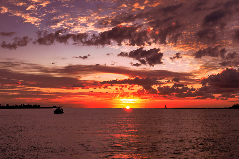 Red coloured stratocumulus cloud, supernal sunset seascape. Australia.