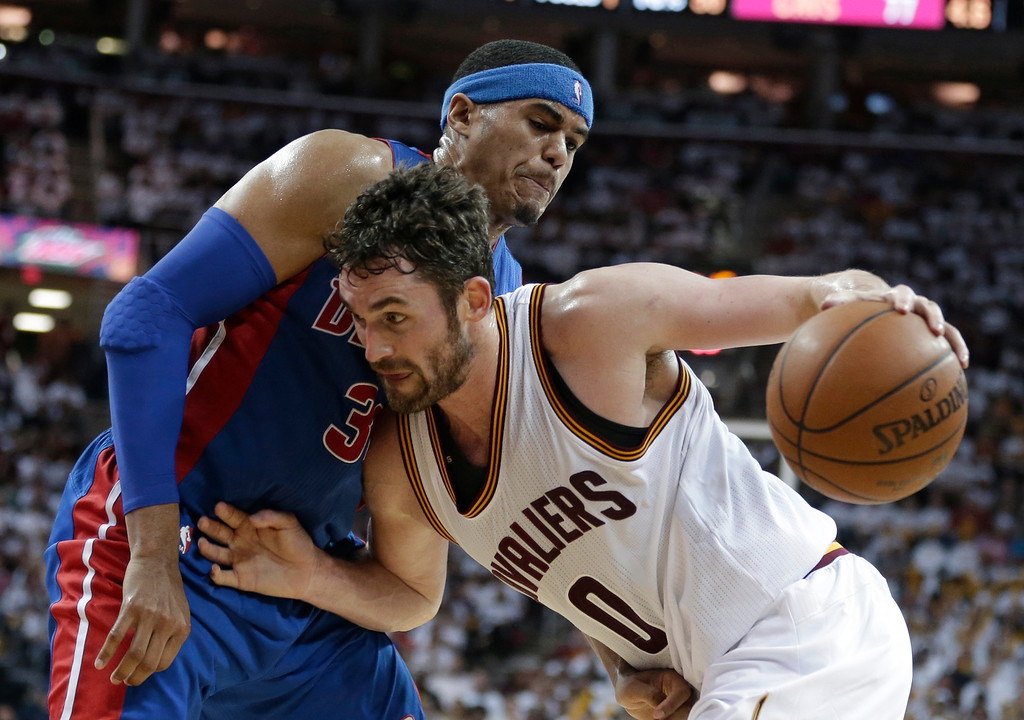 . Cleveland Cavaliers\' Kevin Love (0) drives past Detroit Pistons\' Tobias Harris (34) in the second half in Game 2 of a first-round NBA basketball playoff series, Wednesday, April 20, 2016, in Cleveland. The Cavaliers won 107-90. (AP Photo/Tony Dejak)