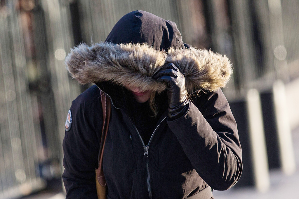 . A woman bundles up against the cold on the morning of January 7, 2014 in New York, United States. A polar vortex has descended on much of North America, coming down from the Arctic, bringing record freezing temperatures across much of the country.  (Photo by Andrew Burton/Getty Images)