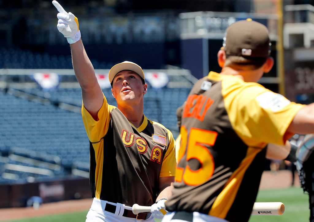 . U.S. team\'s Hunter Renfroe, of the San Diego Padres, points upward during team workouts prior to the All-Star Futures baseball game, Sunday, July 10, 2016, in San Diego. (AP Photo/Lenny Ignelzi)