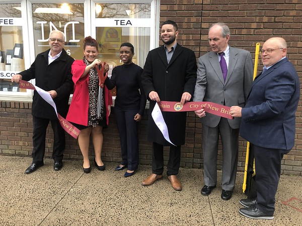 Ribbon Cutting for INI Sips 2