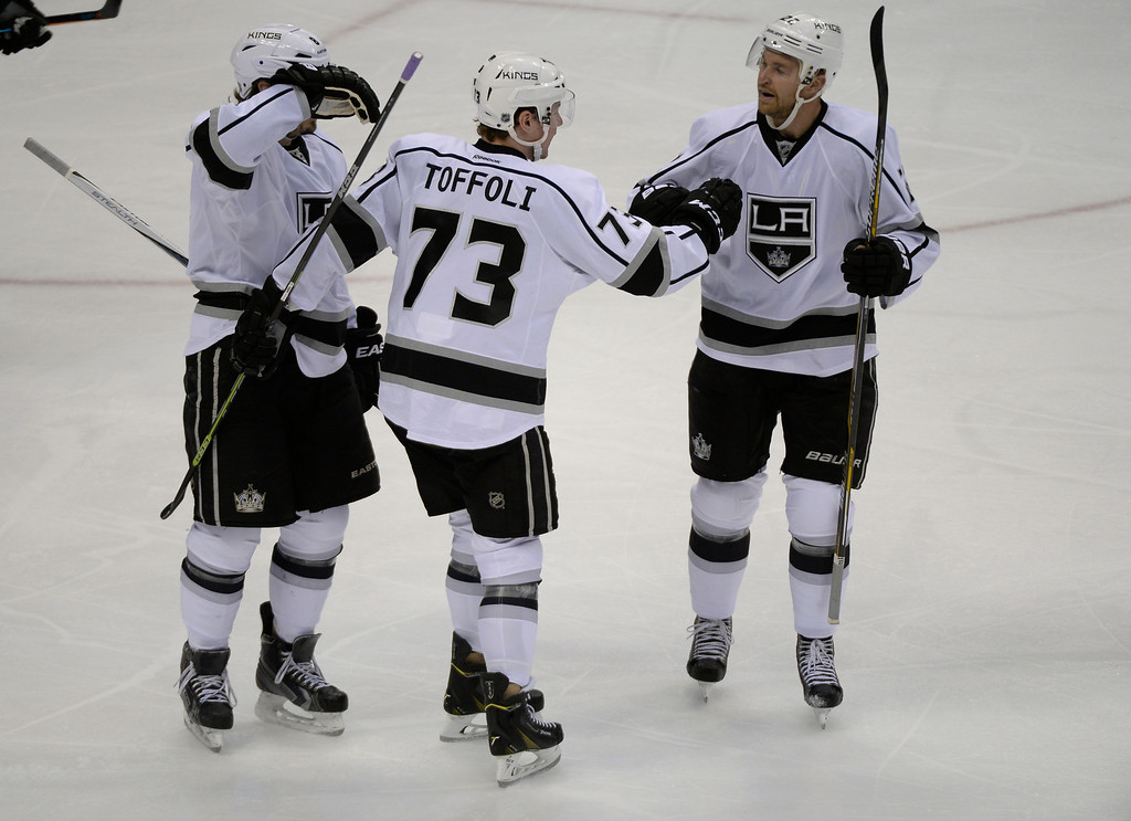 . DENVER, CO - FEBRUARY 18: Los Angeles Kings center Tyler Toffoli (73) celebrates his goal with Los Angeles Kings center Trevor Lewis (22) and Los Angeles Kings defenseman Drew Doughty (8) during the second period against the Colorado Avalanche February 18, 2015 at Pepsi Center. (Photo By John Leyba/The Denver Post)