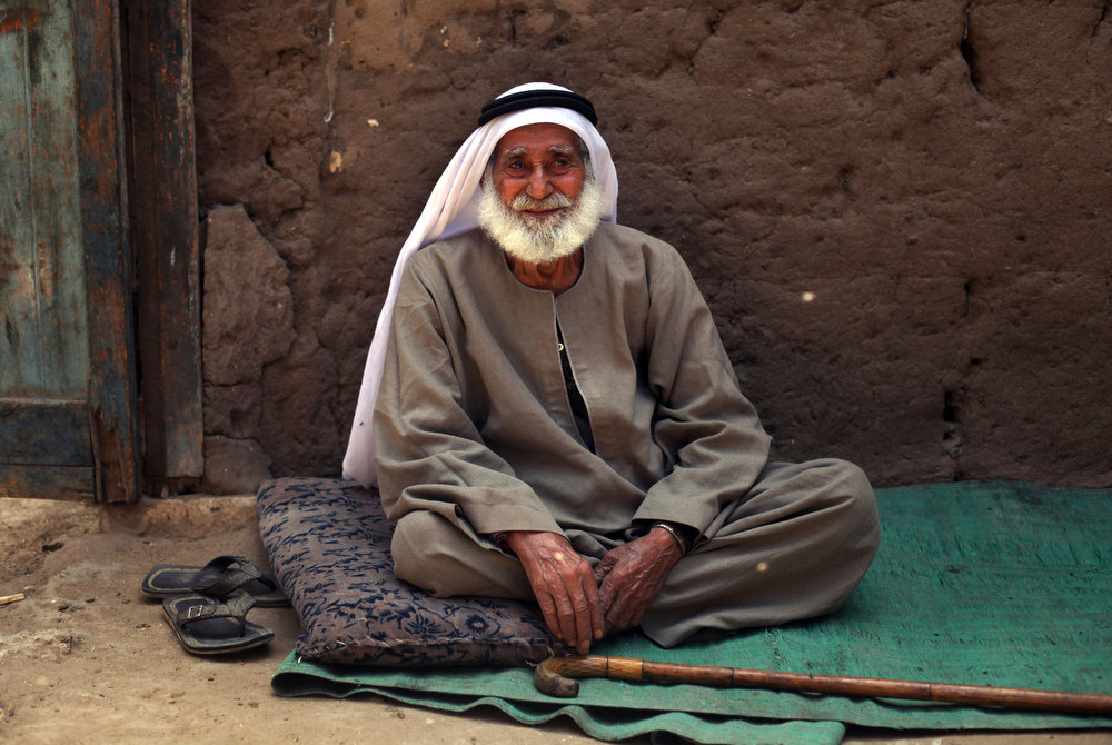 . Palestinian refugee Sulaiman al-Namodi, 92, sits outside of his house in Gezirat al-Fadel village, Sharqiya, about 150 kilometers (93 miles) east of Cairo, Egypt.  (AP Photo/Khalil Hamra)