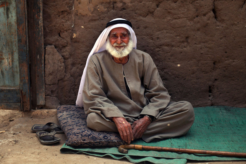 . Palestinian refugee Sulaiman al-Namodi, 92, sits outside of his house in Gezirat al-Fadel village, Sharqiya, about 150 kilometers (93 miles) east of Cairo, Egypt.  (AP Photo/Khalil Hamra)
