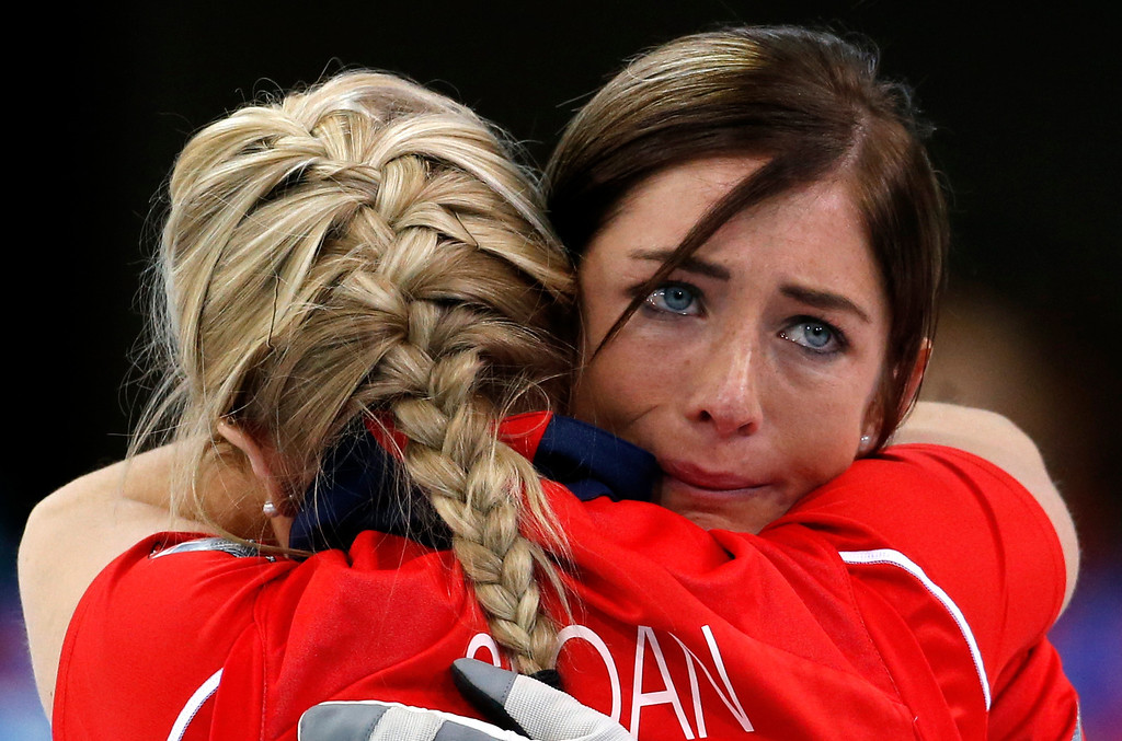 . Britain\'s skip Eve Muirhead, right, embraces Anna Sloan after defeating Switzerland to win the women\'s curling bronze medal at the 2014 Winter Olympics, Thursday, Feb. 20, 2014, in Sochi, Russia. (AP Photo/Robert F. Bukaty)