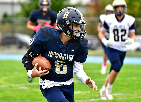 10/12/2019 Mike Orazzi | StaffrNewington High School's Nicholas Pestrichello (6) runs for a TD during Saturday's football game with Platt in Newington.