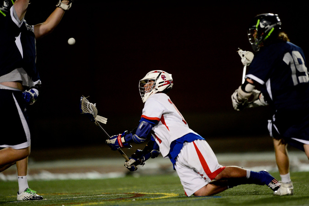 . Cherry Creek\'s Trip Dehaven trips as he shoots on goal against Columbine during Cherry Creek\'s 7-6 win.  (Photo by AAron Ontiveroz/The Denver Post)