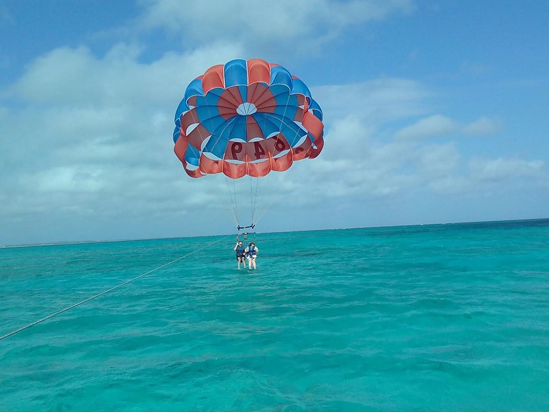 Boomer travel - fun adventures - Parasailing over Grace Bay is a fun boomer travel adventure in Turks and Caicos.