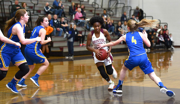 12/31/2019 MIke Orazzi | StaffrBristol Central's Damani Hough (2) and Gilbert's Ajla Gutic (23) and Kim McCarthy (4) during Tuesday's girls basketball game in Bristol.