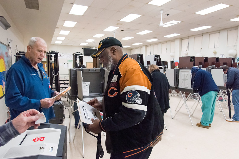 11/06/18  Wesley Bunnell   Staff  Tabulation Tender Carl Symecko, L, helps Allen Wilkins to enter his ballot into the tabulation machine at the Pulaski Middle School voting location on Tuesday afternoon.