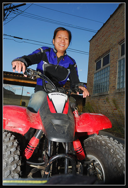 OMG she is so cute. Posing on LJ's Suzuki 50cc Quad