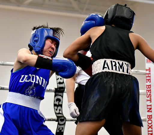 3/16/2019 Mike Orazzi | Staff West Points Ahliyah Lablue (red) and UConns Corona Zhang (blue) in a 115 match during the National Collegiate Boxing Association National Qualifier held at the Bristol Boys & Girls Club in Bristol, Conn. on Saturday.