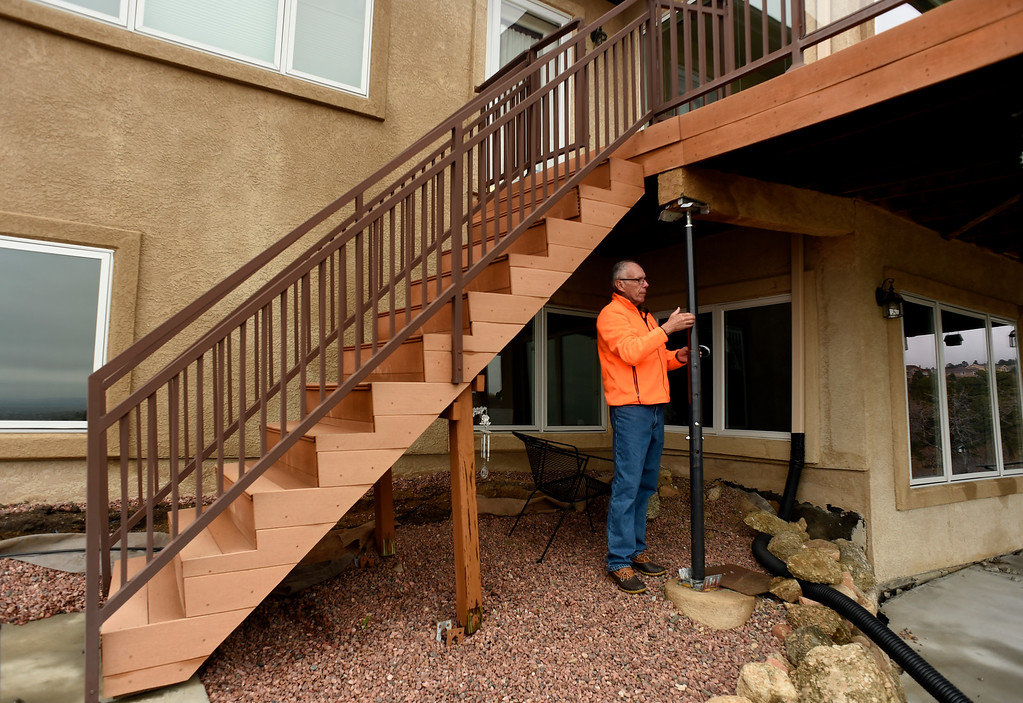 . Homeowner Denny  Cripps checks out a steel pole now being used to prop up his porch at his house in Broadmoor Bluffs on April 11, 2016 in Colorado Springs, Colorado.  The Cripps are among 200 homeowners who have applied for federal bailouts because their home is being eaten up by collapsing expansive soil that is part of an ancient and massive landslide area.  Their home has cracked walls, uneven floors and is literally sliding down the mountain.  It is a problem that city officials have known about since the mid-1990\'s when city planners approved developments on what geologists have called some of the most unstable geology on the front range.  (Photo by Helen H. Richardson/The Denver Post)