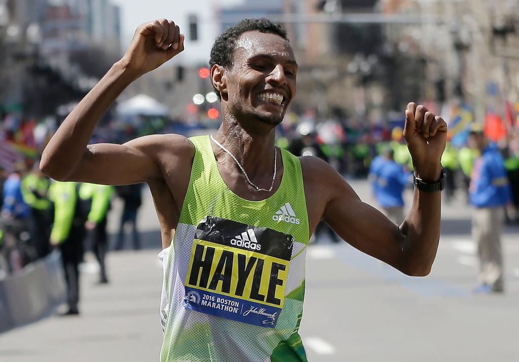 . Lemi Berhanu Hayle, of Ethiopia, celebrates after winning the 120th Boston Marathon on Monday, April 18, 2016, in Boston. (AP Photo/Elise Amendola)