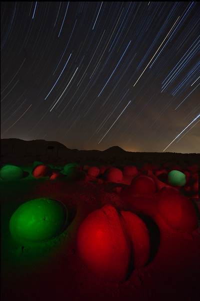 The Pumpkin Patch at night with star trails. I used  gel filters for the lighting. These are weird sandstone concreations that formed millions of years ago around a bit of shell, an insect or a pebble & over the years have been revealed by erosion. Anza Borrego State Park