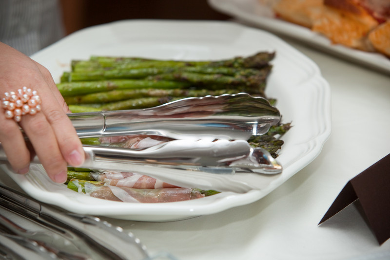 Isa goes for the prosciutto wrapped asparagus