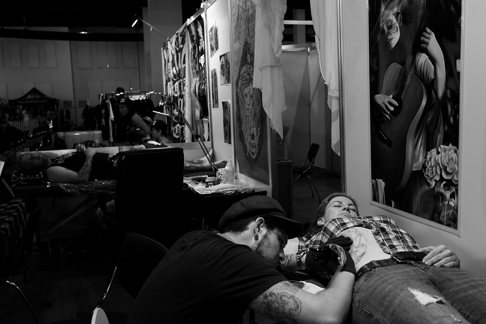 . Tattoo artist Jimi May works on a woman\'s stomach during The Australian Tattoo & Body Art Expo at the Royal Hall of Industries, Moore Park on March 8, 2013 in Sydney, Australia. The annual three day event showcases some of Australia\'s best tattoo and body artists and is open to enthusiasts March 8-10.  (Photo by Lisa Maree Williams/Getty Images)